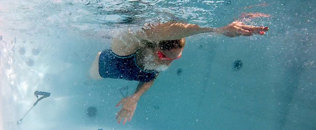 Swim-Spa-woman-swimming-sm-1024x421
